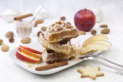 Waffles with apples and cinnamon Stock Photos