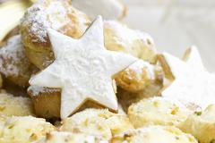 Stollen bites and star-shaped biscuits topped with coconut Stock Photos
