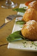Deep Fried Risotto Balls on a Platter with Parmesan Cheese Stock Photos