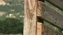 Zoom out of a old cattle ramp New Mexico green grass cutaway transition  Stock Footage