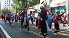 People in traditional clothing costumes take part in dance parade in Japan Stock Footage