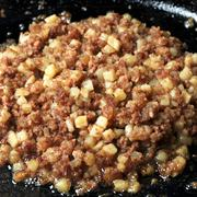 Canned Corned Beef Hash Frying in a Skillet Stock Photos