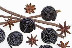 Liquorice whirls, star anise and liquorice Stock Photos