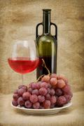 green bottle, goblet and grapes - stock photo