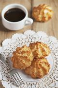 Coconut Macaroons on a Doily with a Cup of Coffee Stock Photos