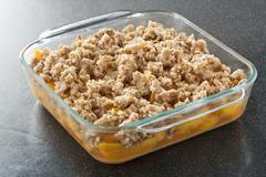Fruit Crisp in Baking Dish Ready to be Baked Stock Photos