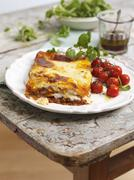 Lasagne with oven roasted tomatoes - stock photo
