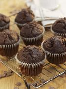 Chocolate muffins on a wire rack Stock Photos