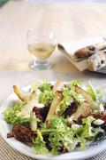 Frisee lettuce salad with pear, feta and fried Pancetta - stock photo