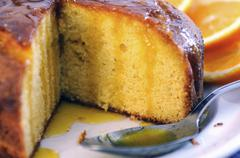 Sliced semolina cake with orange syrup (close-up) Stock Photos