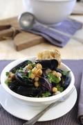 Mussels with chickpeas and chillis - stock photo