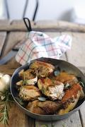 Fried guinea fowl with rosemary and sage Stock Photos