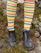 Amusing striped feet in boots Stock Photos