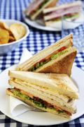 A club sandwich (chicken, lettuce, tomatoes and mayonnaise) - stock photo