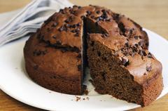 Chocolate chip cake, sliced - stock photo