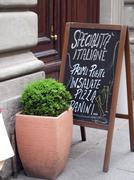 A menu at the entrance of a restaurant (Milan, Italy) - stock photo