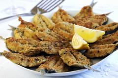 Fried sardines with a herb and Parmesan crust - stock photo