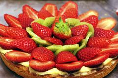An Italian strawberry and kiwi tart Stock Photos