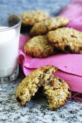 Oat biscuits and a glass of milk Stock Photos