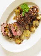 Stuffed roast lamb Stock Photos