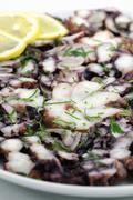 Squid carpaccio with herbs and lemon Stock Photos