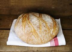 Stock Photo of Boule (French white bread) on a tea towel