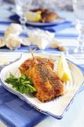 Stuffed and breaded fillets of anchovies - stock photo