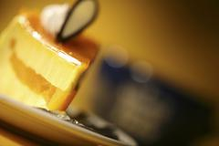 A slice of cheese cake Stock Photos