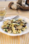 Potato gnocchi with fresh porcini mushroom sauce Stock Photos