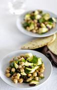 Plates of Chickpea and Zucchini Salad with Pita Breads Stock Photos