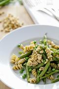 Pasta with Green Beans, Peas and Pine Nuts; In a White Bowl Stock Photos