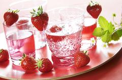 Strawberry lemonade and fresh strawberries - stock photo