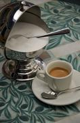 An espresso and a sugar pot - stock photo