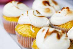 Lemon cupcakes topped with meringue Stock Photos