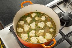 Dumplings Cooking in a Pot of Chicken Stew; From Above Stock Photos