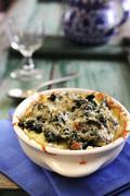 Potato, spinach and cheese bake Stock Photos