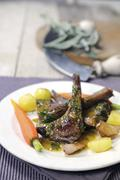 Lamb chops with potatoes, carrots and a parsley and mustard sauce - stock photo