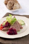 Stock Photo of Ardenne pate with lingonberry jam and side salad