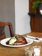 Saddle of lamb with mashed leek and cranberry sauce - stock photo