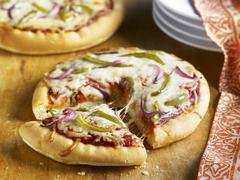Personal Pizza Topped with Onion and Peppers; Sliced - stock photo