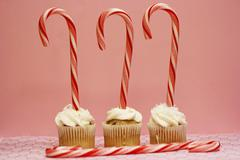 Three Cupcakes with Candy Canes - stock photo