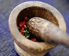 Ingredients for chilli paste in a mortar - stock photo