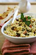 Couscous with dried tomatoes, peppers and courgette Stock Photos