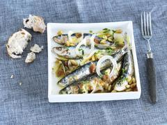 Marinated sardines with onions and pine nuts Stock Photos