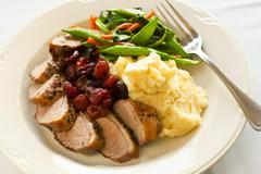 Stock Photo of Sliced Duck Breast with Cherries, Mashed Potato and Mixed Vegetables
