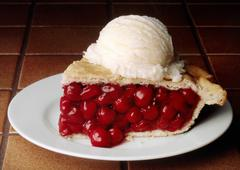 Slice of Cherry Pie with a Scoop of Vanilla Ice Cream - stock photo