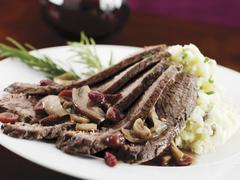 Stock Photo of Sliced Brisket with Cranberries and Mushrooms; Served with Mashed Potatoes
