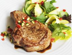 Veal Chop with Salad Stock Photos
