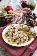 Mixed bruschetta topped with tuna and caper paste and artichoke paste - stock photo