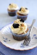 Blackberry and apple cupcake with a crumble topping Stock Photos
